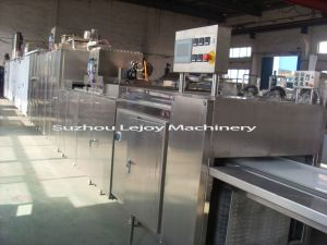 Chocolate Machine Chocolate Moulding Line (3-steps depositing) pictures & photos