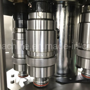 Running Stablely Glass Bottle Filling Capping Machine pictures & photos