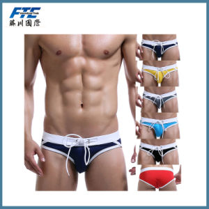 Hot-Sale Men′s Swim Trunks in Swimming Pool or on Sandbeach pictures & photos