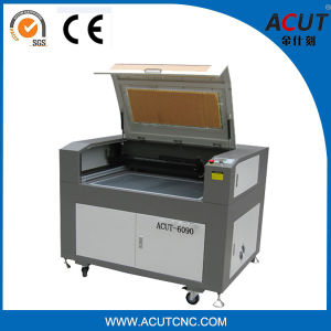 6090 3D Photo Crystal Laser Engraving Machine for Jeans pictures & photos