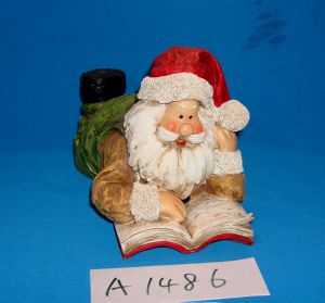 Santa Reading Book for Christmas Decoration pictures & photos