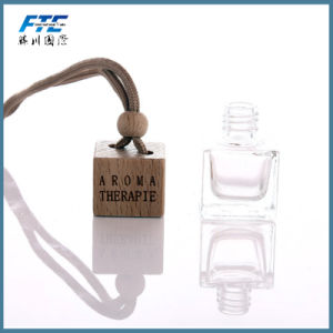 Fashion Clear Air Glass Perfume Bottles with Wooden Caps pictures & photos