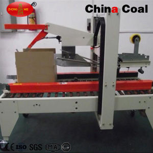 Fxj 6050 Self Adhesive Tape Carton Sealing Machine pictures & photos