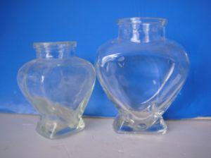 Wholesale Heart Design Glass Bottle/Food Storage Jar pictures & photos