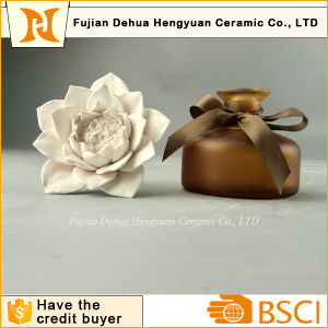 High Quality Perfume Bottle with Ceramic Flower Cap pictures & photos