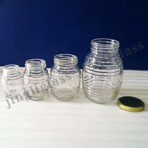 Round Ribbed Glass Jar for Honey / Honey Glass Jar pictures & photos