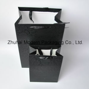 OEM UV Coating /Logo Stamping /with Ribbon Handle Paper Bag pictures & photos