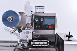 Auto Flow Machine Film Meat Biscuits Wrapping Machine pictures & photos
