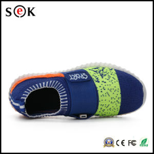 Sport Light up Shoe Children LED Light Running Shoes for Kids pictures & photos
