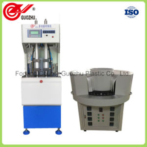 Hand-Feeding Bottle Blow Molding Machine pictures & photos