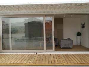 Super-House Hot Sale Aluminium Glass Folding Door with 24 Years Warranty pictures & photos