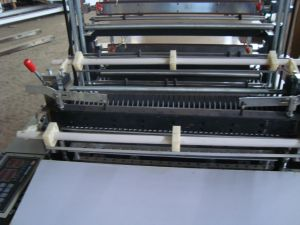 Double Layer Four Line Cold Cutting Bag Making Machine with Conveyor (SHXJ-700FC) pictures & photos