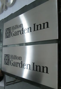 Hotel Outdoor Garden Entrance Hall Floor Wall Identity Classfication Information Directionals Directory Sign pictures & photos