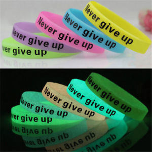 OEM Custom Debossed Silicone Rubber Glow in Dark Wristbands pictures & photos