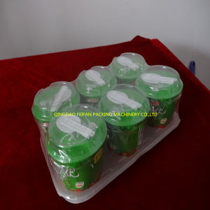 China Factory Price Automatic Yogurt Cup Shrink Packing Machine pictures & photos