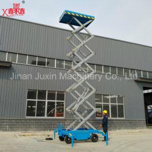 Four Wheels Pulled Scissor Lift Platform pictures & photos