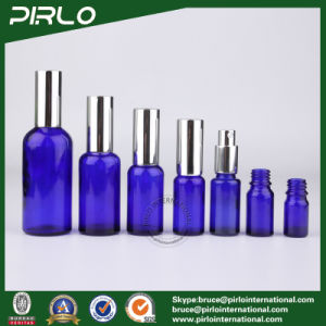 Cobalt Blue Bottles with Silver Pump and Cap pictures & photos