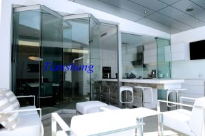 Frameless Tempered Folding Glass Doors pictures & photos
