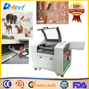 Small CO2 Laser Cutter CNC Cutting Wood Arts Crafts Engraver pictures & photos