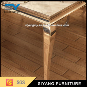 Stainless Steel Furniture Marble Dining Table with 6 People pictures & photos