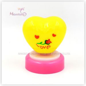 Yellow Heart Shape Push Light pictures & photos