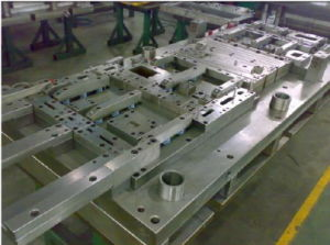China Low Cost Progressive Mold Metal Stamping Die pictures & photos