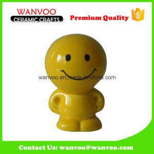 Stoneware Yellow Cartoon Personage Kid Toy for Money Bank pictures & photos
