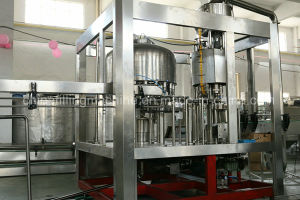 Ce Quality Oil Filling Capping Machine with SUS304 Material (1200-10000bph) pictures & photos