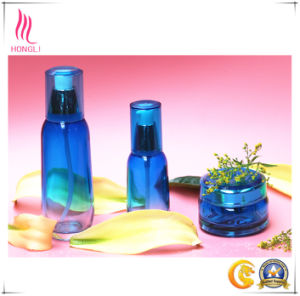 Transparent Blue Glass Spray Bottle and Cream Jar pictures & photos