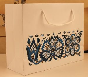 Paper Cosmetics Bags/ Paper Clothes Bag pictures & photos