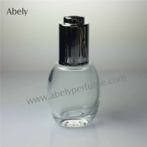 Small Volume Sprayer Glass Perfume Oil Bottle with Pump pictures & photos