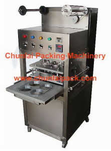 Automatic Vertical Vacuum Yoghurt Cup Sealing Machine pictures & photos