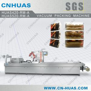 Automatic Stretch Film Packaging Machine for Pasta, Cookies, Bread, Noodles and Cakes pictures & photos