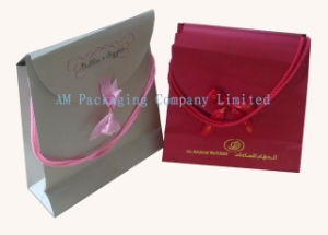 Custom Elegant Gift Paper Bag with Ribbon Bow pictures & photos