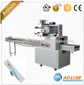 High Quality Semi-Automatic Soap Horizontal Packing Machine Comb Tooth Brush Wrapping Machine pictures & photos