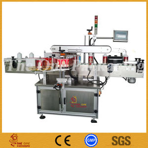 Double Side Labeling Machine / Two Side Round Bottle Labeling Machine pictures & photos