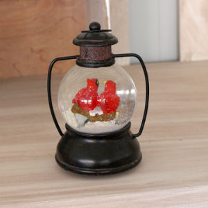 2017 New Design Resin Parrot Snow Globe with Music pictures & photos