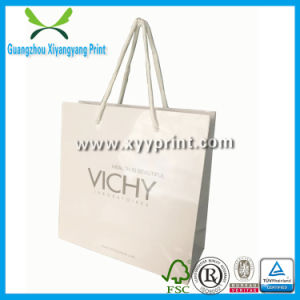 Luxury Handmade White Kraft Shopping Paper Packaging Bag with Logo Printed pictures & photos
