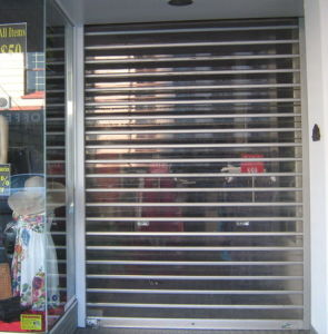 Commercial Aluminum Rolling Grilles Polycarbonate Corrugated Storm Panel Shutters Door (Hz-PRS06) pictures & photos