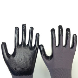 Nylon Glove with Smooth Nitrile Coating pictures & photos