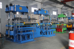 500t Two Stations Vacuum Pump Rubber Silicone Molding Machine Made in China pictures & photos