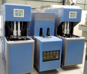 Semi Automatic Blowing Machine for Pet Bottle Hot Filled Juice pictures & photos