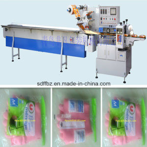 Full Automatic Rubber Gloves Flow Wrapping Machine pictures & photos