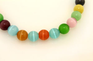 Wholesale Synthetic Cat′s Eye Loose Strand 6 8 10 12 14mm Round Rainbow Opal pictures & photos