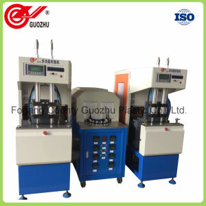 Pet Juice Bottle Semi-Automatic Stretch Blow Molding Machinery pictures & photos
