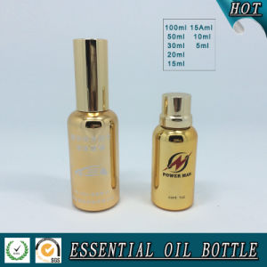 50ml Gold Glass Essential Oil Bottle with Gold Sprayer Pump pictures & photos