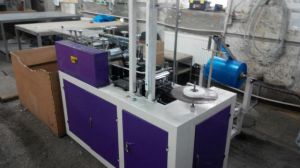 Shoe Cover Making Machine with Round Elastic for Pakistan pictures & photos
