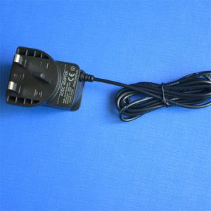 UK BS Plug 24V 0.5A 12V 1000mA Switching Power Adapter pictures & photos
