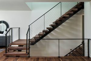 Cantilevered Steel Staircase with Solid Wood Stair Tread and Powder Coated Black Color Cable Railing pictures & photos
