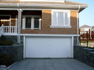 Chinese Automatic Sectional Garage Door pictures & photos